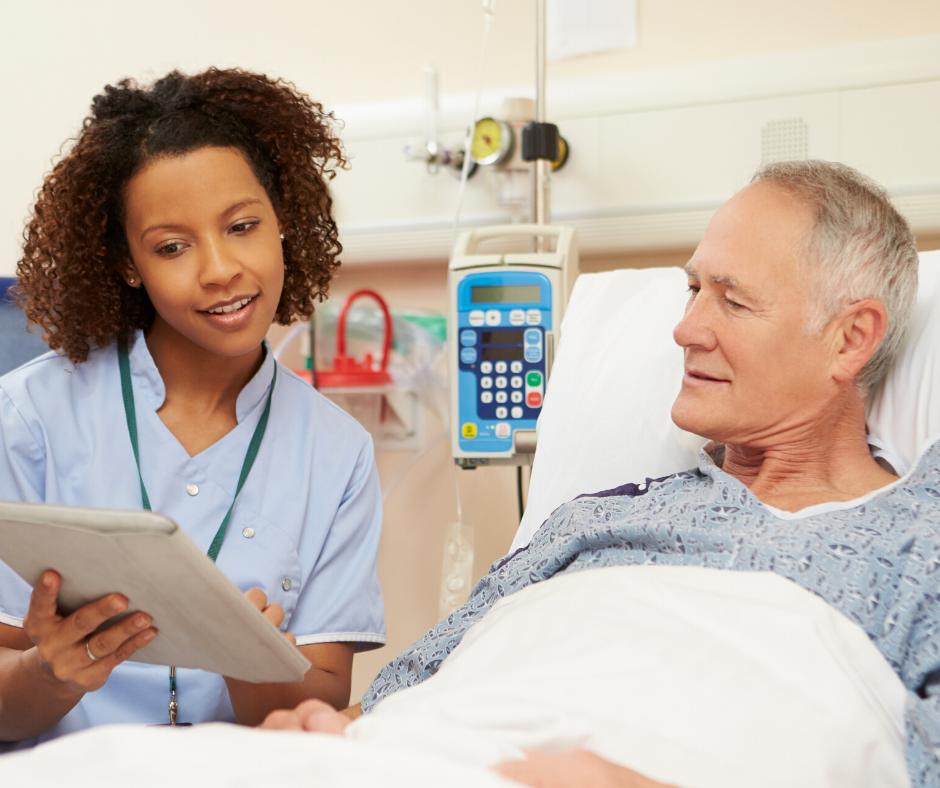 male patient on a hospital bed with a nurse explaining something